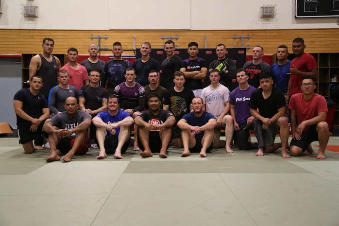 Marines and mixed martial arts fighters pose for a picture
