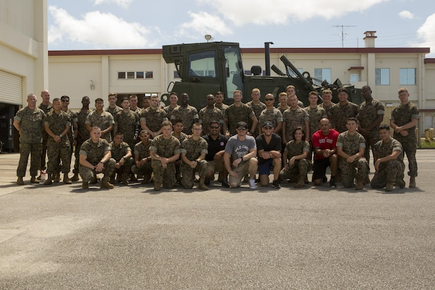 Mixed martial arts fighters and Combat Logistics Regiment 35 poses for a picture