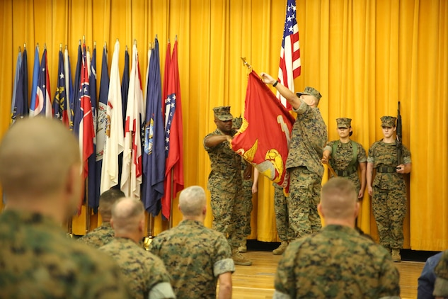 Col. Brian M. Howlett (right), commanding officer, III Marine Expeditionary Force Information Group, and Sgt. Maj. Mario P. Fields, sergeant major of III MIG, case the III MEF Headquarters Group colors during the III MIG re-designation ceremony on Camp Courtney, Okinawa, Japan Sept. 8, 2017.