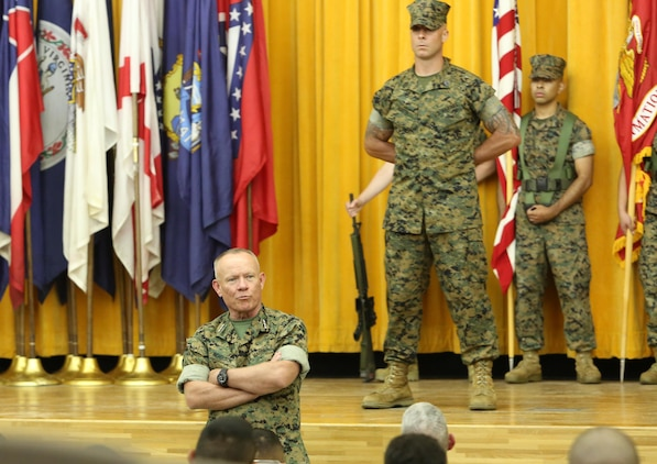 Lt. Gen. Lawrence D. Nicholson, commanding general, III Marine Expeditionary Force, addresses the crowed during the III MEF Headquarters Group re-designation ceremony at Camp Courtney, Okinawa, Japan on Sept. 8, 2017.