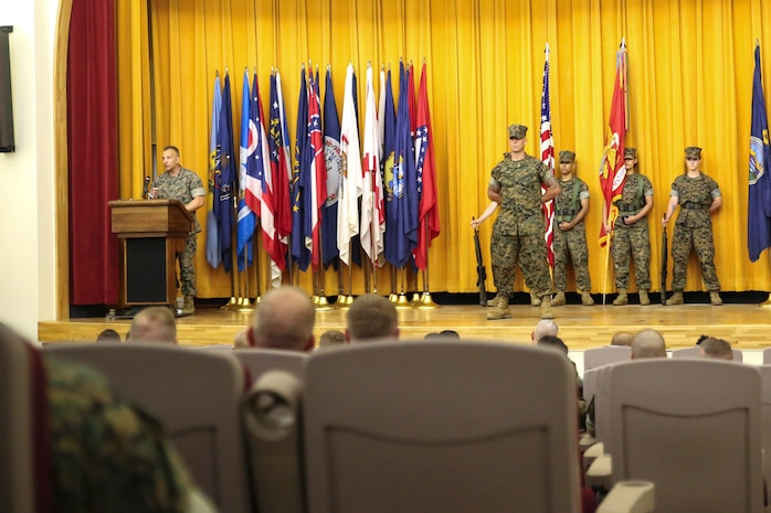 Col. Brian M. Howlett (left), commanding officer, III Marine Expeditionary Force Information Group, addresses the audience during the III MIG re-designation ceremony on Camp Courtney, Okinawa, Japan Sept. 8, 2017.