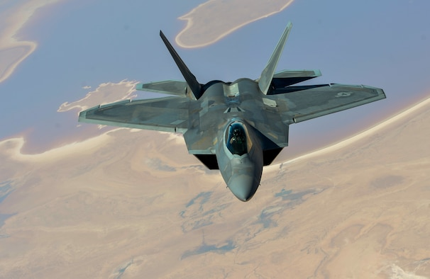 An F-22 Raptor departs after receiving fuel from a KC-135 Stratotanker, assigned to the 340th Expeditionary Air Refueling Squadron, during a mission in support of Operation Inherent Resolve, Aug. 29, 2017. The F-22 is a component of the Global Strike Task Force, supporting U.S. and coalition forces working to liberate territory and people under the control of ISIS. (U.S. Air Force photo by Staff Sgt. Michael Battles)