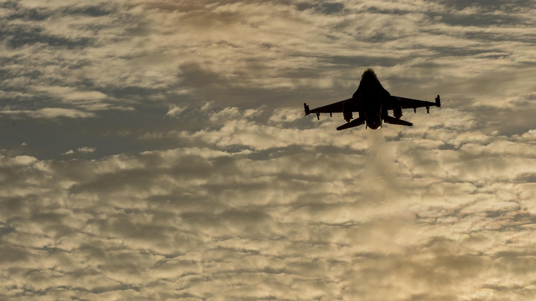 """An F-16 Fighting Falcon, assigned to the 35th Fighter Wing, conducts a touch-and-go landing at Misawa Air Base, Japan, Aug. 31, 2017. Misawa AB personnel operate in the """"fight tonight"""" mentality, providing worldwide deployable forces, protecting U.S. allies within the Indo-Asia-Pacific region, sustaining a forward presence and providing focused mission support. If a real-world incident occurs, Misawa AB transforms into a power projection hub for contingency operations, supporting forward-deployed assets. (U.S. Air Force photo by Staff Sgt. Deana Heitzman)"""