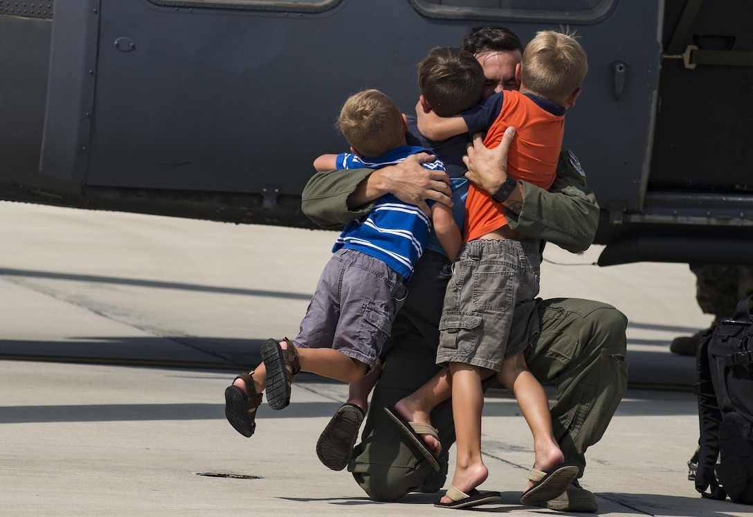 Children greet their father on the flightline after his return from supporting Hurricane Harvey Relief efforts, Sept. 3, 2017, at Moody Air Force Base, Ga. Aircrew, maintenance and support personnel from the 23rd Wing returned to Moody AFB after supporting relief efforts in the aftermath of Hurricane Harvey in Texas. (U.S. Air Force photo by Andrea Jenkins)