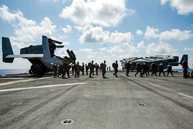 U.S. Marines with Battalion Landing Team 2nd Battalion, 6th Marine Regiment, 26th Marine Expeditionary Unit (MEU), conduct preliminary boarding procedures on a CH-53E Super Stallion helicopter and MV-22B Osprey aircraft with Marine Medium Tiltrotor Squadron 162 (Reinforced), 26th MEU, aboard the amphibious assault ship USS Kearsarge (LHD 3) in the Atlantic Ocean, Sept. 7, 2017. The preparations ensure the 26th MEU is ready to respond to any requests to bolster Northern Command's support of FEMA's assistance to federal, state and local authorities' ongoing relief efforts in the aftermath of Hurricane Irma.