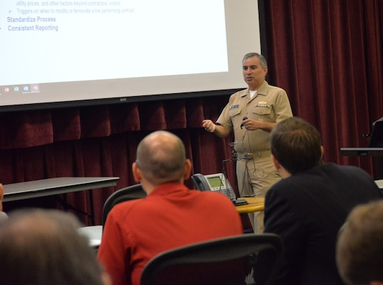 Navy Cmdr. Walter Ludwig, representing the Office of the Assistant Secretary of Defense for Energy, Installations and Environment, addresses Energy Savings Performance Contracting Measurement and Verification Workshop attendees Aug. 29.