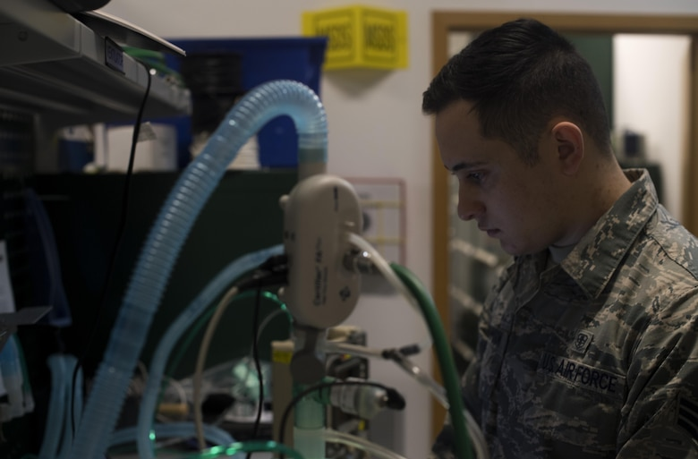 U.S. Air Force Senior Airman Dustin Johnson, 86th Medical Support Squadron biomedical maintenance technician, calibrates a ventilator to ensure it is in perfect working condition on Ramstein Air Base, Germany, Sept. 7, 2017. Johnson and his fellow Airmen service all equipment that is used to support aeromedical evacuation patients. (U.S. Air Force photo by Senior Airman Tryphena Mayhugh)