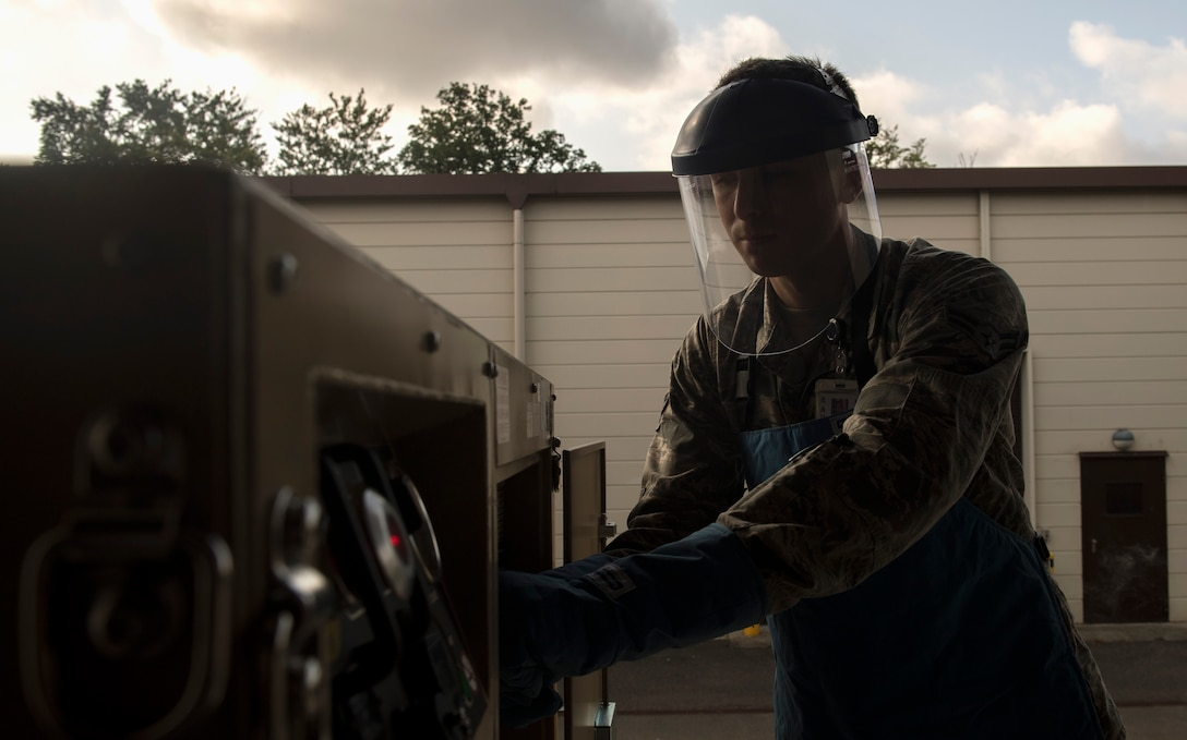 U.S. Air Force Airman 1st Class Ryan Thomas, 86th Medical Support Squadron biomedical equipment technician, adjusts the settings on an oxygen generator and liquefier on Ramstein Air Base, Germany, Sept. 7, 2017. The OGL is used to fill medical equipment with liquid oxygen and was recently purchased by the 86th MDSS, along with a nitrogen generator, to cut their turnaround time for filling the equipment from three weeks to two or three days and to save the Air Force approximately $7,000 a month. (U.S. Air Force photo by Senior Airman Tryphena Mayhugh)