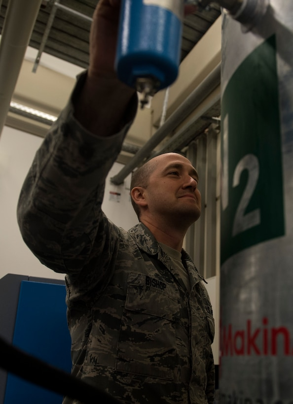 U.S. Air Force Staff Sgt. Jason Bishop, 86th Medical Support Squadron noncommissioned officer in charge of clinical maintenance, checks the settings for a nitrogen generator on Ramstein Air Base, Germany, Sept. 7, 2017. The 86th MDSS recently purchased the generator to replace using tanks that required refilling and two Airmen to safely operate, saving the Air Force man hours and approximately $7,000 a month.  (U.S. Air Force photo by Senior Airman Tryphena Mayhugh)