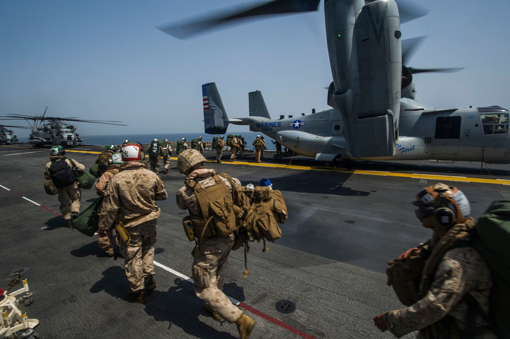 Marines assigned to the 15th Marine Expeditionary Unit aboard the amphibious assault ship USS America (LHA 6) board an MV-22 Osprey assigned to Marine Medium Tiltrotor Squadron (VMM) 161 (Reinforced) for a scheduled departure to Djibouti in support of exercise Alligator Dagger 2017. Alligator Dagger is a dedicated, unilateral combat rehearsal led by Naval Amphibious Force, Task Force 51/5th Marine Expeditionary Brigade, in which combined Navy and Marine Corps units of the America Amphibious Ready Group and embarked 15th Marine Expeditionary Unit are to practice, rehearse and exercise integrated capabilities that are available to U.S. Central Command both afloat and ashore. (U.S. Navy photo by Mass Communication Specialist Seaman Apprentice Chad Swysgood/Released)