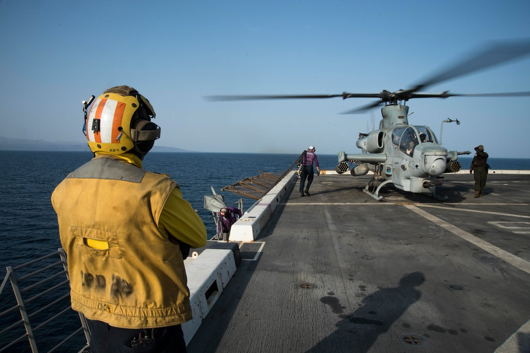 U.S. 5TH FLEET AREA OF OPERATIONS (Sept. 06, 2017) Sailors assigned to the air department aboard the amphibious transport dock ship USS San Diego (LPD 22) prepare to refuel an AH-1Z Viper (USMC), assigned to Marine Medium Tiltrotor Squadron 161 (reinforced) on the ship's flight deck during Alligator Dagger exercise. San Diego is part of the America Amphibious Ready Group and, with the embarked 15th Marine Expeditionary Unit, is in to the U.S. 5th Fleet area of operations in support of maritime security operations to reassure allies and partners, and preserve the freedom of navigation and the free flow of commerce in the region.  (U.S. Navy photo by Mass Communication Specialist 3rd Class Justin A. Schoenberger/Released)