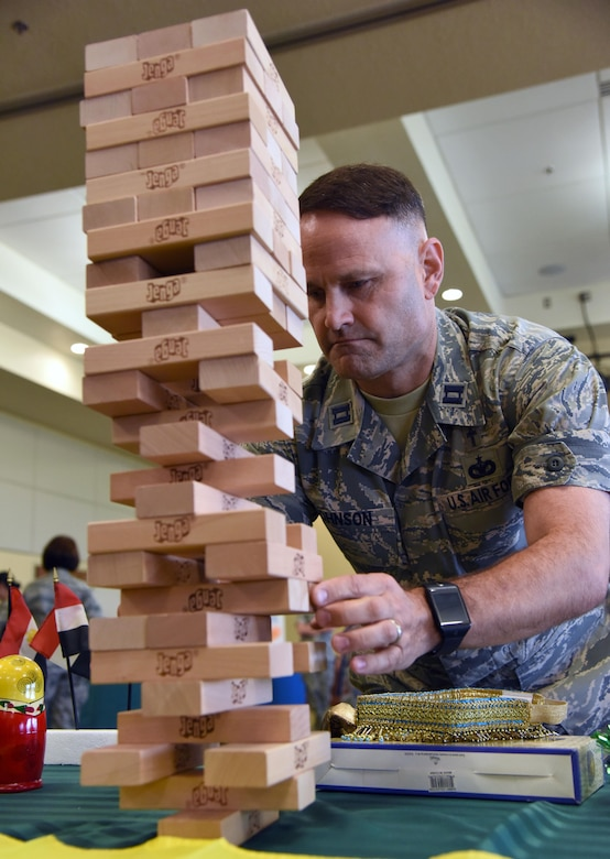 Chaplain (Capt.) Michael Johnson, 81st Training Wing chaplain, participates in a game during Diversity Day at the Bay Breeze Event Center Sept. 6, 2017, on Keesler Air Force Base, Miss. The cultural celebration included food sampling and information booths about countries around the world and other special emphasis groups. (U.S. Air Force photo by Kemberly Groue)