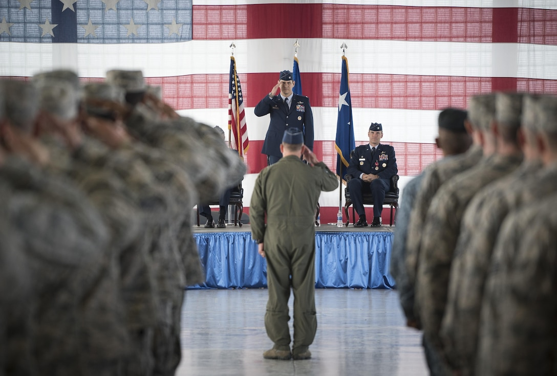 Col. Joseph Kunkel, 366th Fighter Wing commander, salutes the wing for the first time at the end of a change of command ceremony at Mountain Home Air Force Base, Idaho, Sept. 8, 2017. The outgoing commander, Col. Jefferson O'Donnell, will become the Director, Air Force Colonels Management Office, at the Pentagon. (U.S. Air Force photo/Senior Airman Samuel Morse)