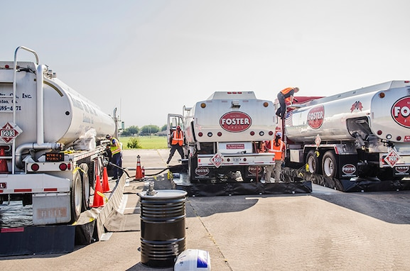 Three fuel trucks being filled at Fort Hood Army Airfield, Fort Hood, Texas.