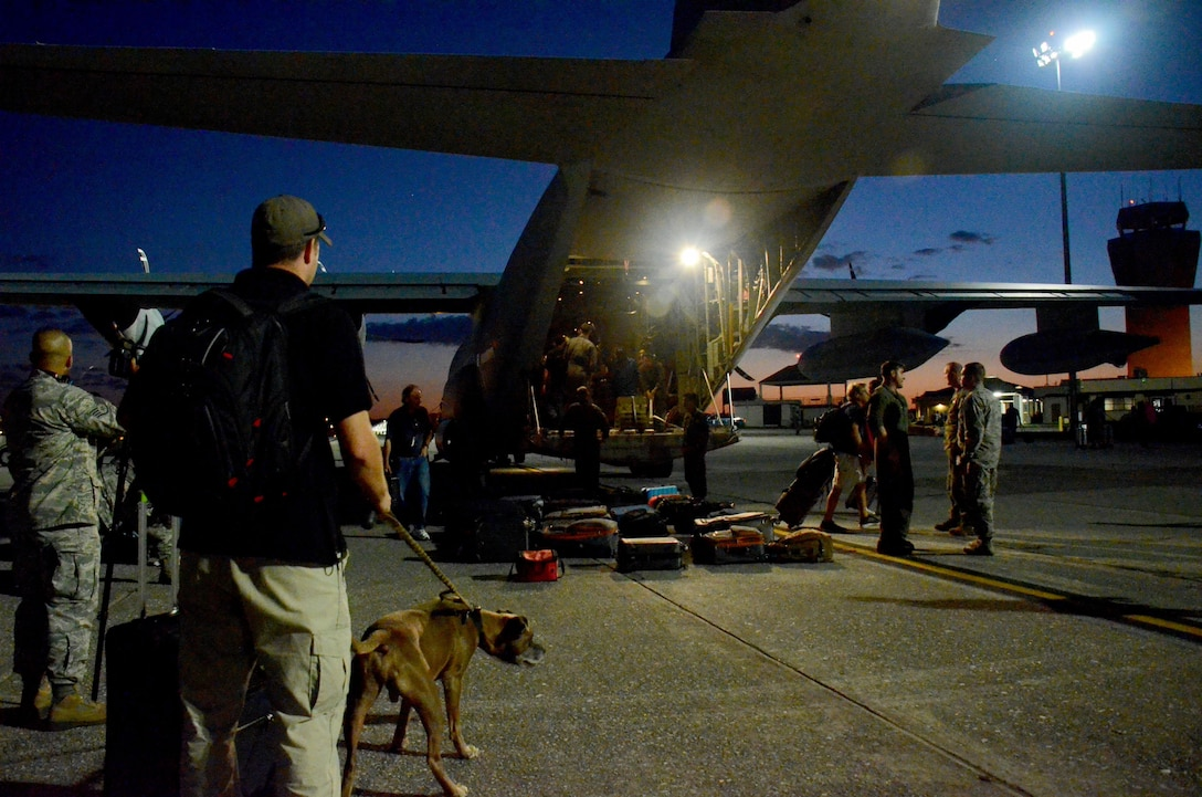 Evacuees retrieve their luggage from the flightline at Dobbins Air Reserve Base, Ga. Sept. 6, 2017. The aircraft carried civilian and contract Department of Defense personnel who were evacuated from the Caribbean in anticipation of Hurricane Irma. (U.S. Air Force photo/Don Peek)
