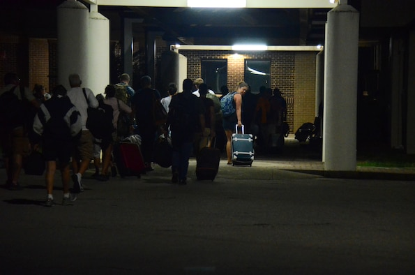 Evacuees exit the flightline at Dobbins Air Reserve Base, Ga. Sept. 6, 2017. Once they exited, they were accounted for and then taken by bus to temporary lodging for the duration of Hurricane Irma. (U.S. Air Force photo/Don Peek)