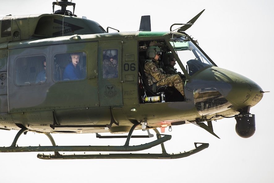 Secretary of the Air Force Heather Wilson flies aboard a 54th Helicopter Squadron aircraft at Minot Air Force Base, N.D., Sept. 7, 2017. On her first trip to Minot AFB as SECAF, Wilson toured both 5th Bomb Wing and 91st Missile Wing facilities and assets. (U.S. Air Force photo/Senior Airman J.T. Armstrong)