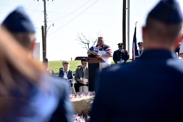 Rosendo Velez, retired New York emergency medical responder, speaks at the 9/11 Memorial Rededication near the San Angelo Museum of Fine Arts in San Angelo, Texas, Sept. 8, 2017. After vandals stole the original piece of metal from the monument, Velez dedicated new steel from the Twin Towers. (U.S. Air Force photo by Staff Sgt. Joshua Edwards/Released)