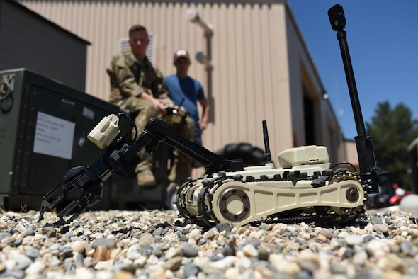 Senior Airman Jared Basham, 9th Civil Engineer Squadron ordnance disposal technician, controls a Micro Tactical Ground Robot to search for a buried training explosive device at Beale Air Force Base, California, July 28, 2017. EOD Airmen use remote controlled robots to neutralize explosives while at a safe distance.