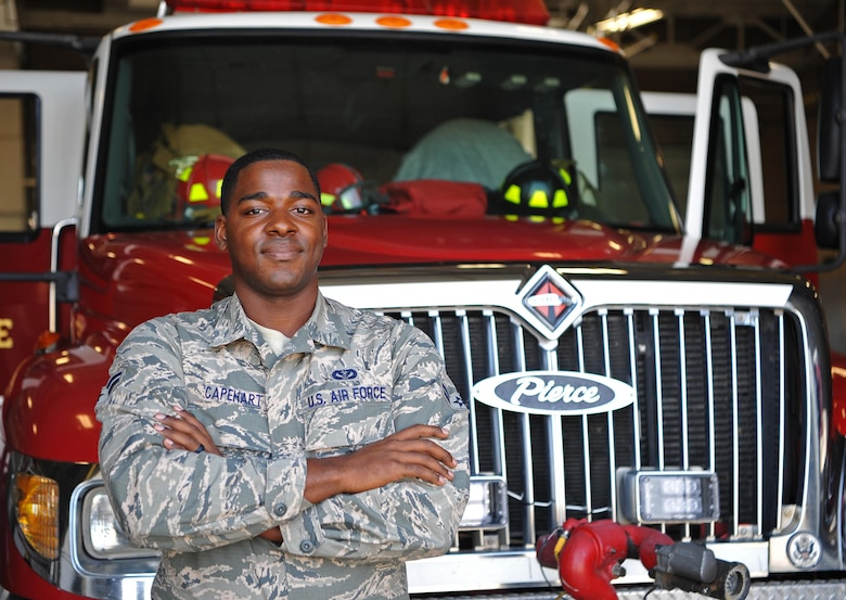 Airman 1st Class Christian Capehart, 9th Civil Engineer Squadron firefighter, poses for a photo.
