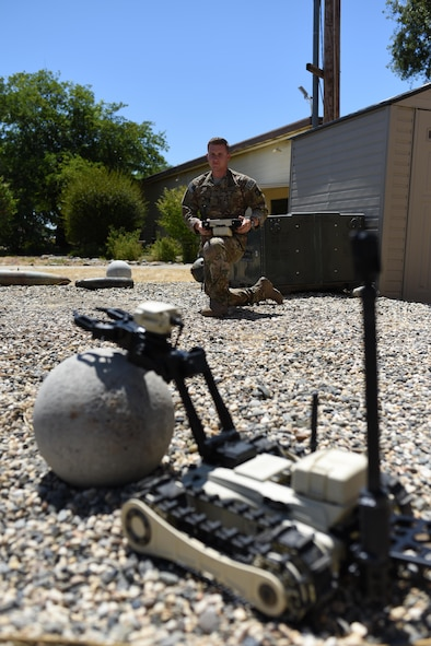 Senior Airman Jared Basham, 9th Civil Engineer Squadron ordnance disposal technician, controls a Micro Tactical Ground Robot during familiarize training at Beale Air Force Base, California, July 28, 2017. The MTGR is a man portable robot meant to be able to transverse any terrain.
