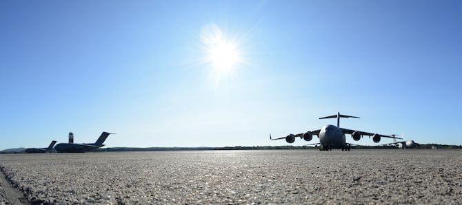 Three C-17 Globemaster IIIs sit on the flightline September 9, 2017, at Westover Air Reserve Base, Mass.  These three C-17s from Joint Base McGuire-Dix-Lakehurst, New Jersey, Joint Base Lewis-McChord, Washington and March ARB, California, are to be loaded with Federal Emergency Management Agency supplies by Westover ARB Reserve Citizen Airmen to assist those impacted by Hurricane Irma. (U.S. Air Force photo by Airman Hanna N. Smith)