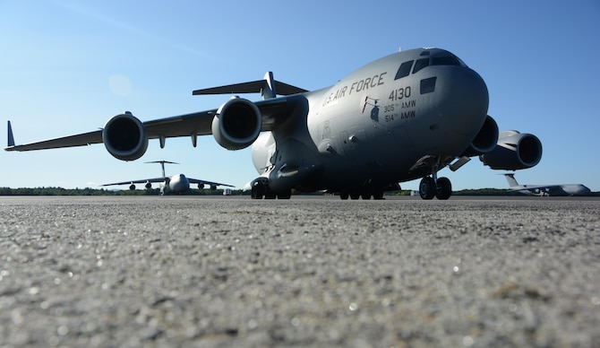 A C-17 Globemaster III sits on the flightline September 9, 2017, at Westover Air Reserve Base, Mass. Three C-17s from Joint Base McGuire-Dix-Lakehurst, New Jersey, Joint Base Lewis-McChord, Washington and March ARB, California, await the loading of Federal Emergency Management Agency supplies by Westover's Aerial Port Squadrons to support those impacted by Hurricane Irma. (U.S. Air Force photo by Airman Hanna N. Smith)