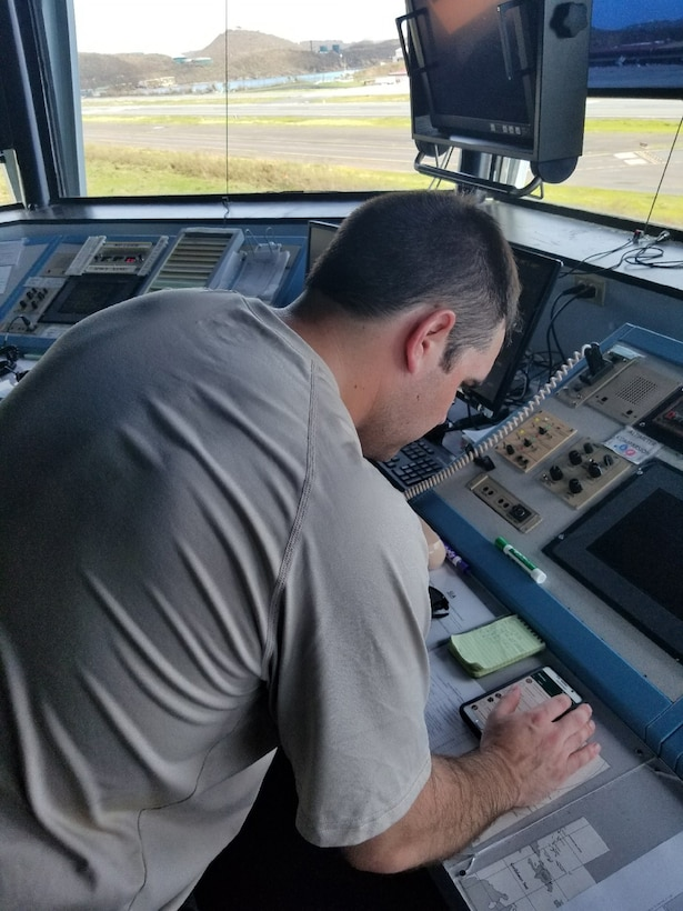 Master Sgt. John Beardsley, a controller fom the Kentucky Air National Guard's 123rd Special Tactics Squadron, provides an assessment of the suitability of aircraft landing zones for airlift evacuations at Cyril E. King International Airport in St. Thomas, U.S. Virgin Islands, in the wake of Hurriane Irma Sept. 8, 2017.