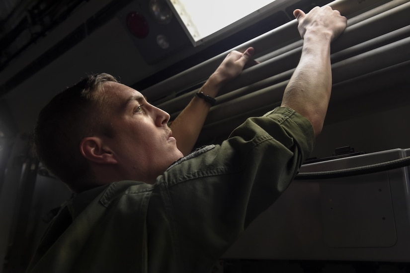 Staff Sgt. Dungan Farver, 16th Airlift Squadron loadmaster, performs a preflight inspection prior to the takeoff of one of the final C-17 Globemaster IIIs out of Joint Base Charleston, South Carolina in preparation for Hurricane Irma Sept. 8, 2017.