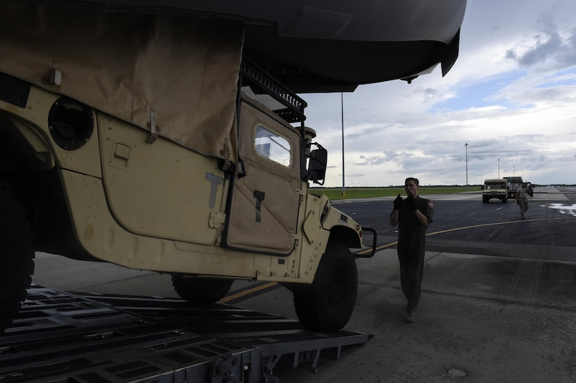 Staff Sgt. Dungan Farver, 16th Airlift Squadron loadmaster, directs a humvee as it backs up to a C-17 Globemaster III at MacDill Air Force Base, Florida, Sept. 8, 2017.