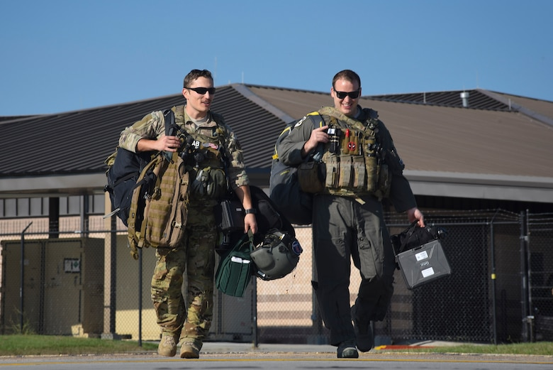 Moody 41st Rescue Squadron HH-60G Pavehawk pilots walk the flighline prior to take off, Sept. 9, 2017, at Moody Air Force Base, Ga. Team Moody aircraft and rescue assets travelled to Columbus Air Force Base, Miss., for shelter before re-engaging with other Moody assets to assist the Federal Emergency Management Agency and other first responder agencies during upcoming Hurricane Irma in the Southeast region. (U.S. Air Force photo by Senior Airman Greg Nash)