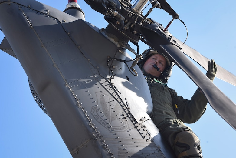 Tech. Sgt. Paul Hiller, 41st Rescue Squadron flight engineer, performs a pre-flight inspection on an HH-60G Pavehawk prior to takeoff, Sept. 9, 2017, at Moody Air Force Base, Ga. Team Moody aircraft and rescue assets travelled to Columbus Air Force Base, Miss., for shelter before re-engaging with other Moody assets to assist the Federal Emergency Management Agency and other first responder agencies during upcoming Hurricane Irma in the Southeast region. (U.S. Air Force photo by Senior Airman Greg Nash)