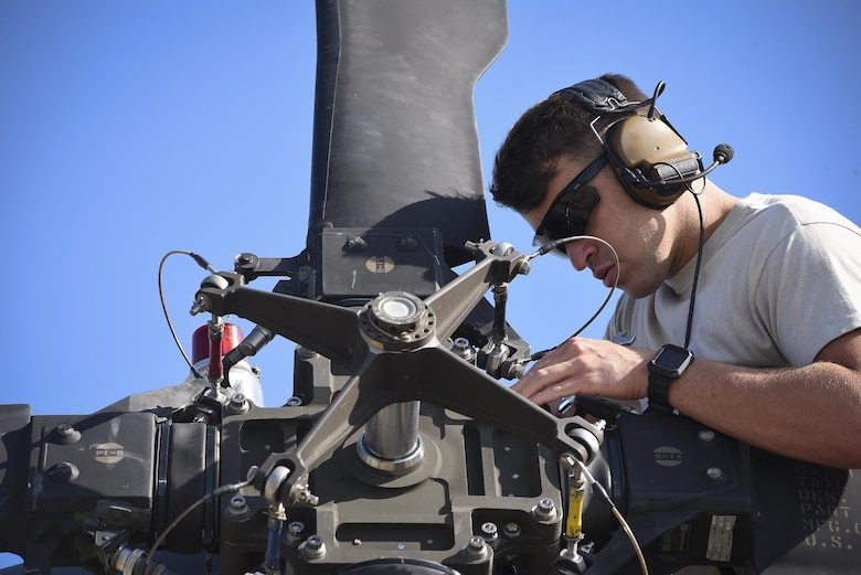 An Airman from the 41st Helicopter Maintenance Unit performs maintenance on an HH-60G Pavehawk prior to takeoff, Sept. 9, 2017, at Moody Air Force Base, Ga. Team Moody aircraft and rescue assets travelled to Columbus Air Force Base, Miss., for shelter before re-engaging with other Moody assets to assist the Federal Emergency Management Agency and other first responder agencies during upcoming Hurricane Irma in the Southeast region. (U.S. Air Force photo by Senior Airman Greg Nash)