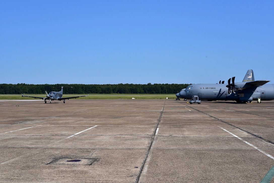 A U-28A assigned to Hurlburt Field, Fla., taxis past C-130Js to a parking spot after landing Sept. 9, 2017, at Little Rock Air Force Base, Ark.