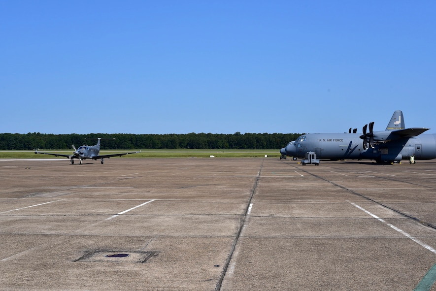 A U-28A assigned to Hurlburt Field, Fla., taxis past C-130Js to a parking spot after landing Sept. 9, 2017, at Little Rock Air Force Base, Ark.
