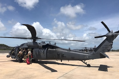 Airmen from the Kentucky Air National Guard's 123rd Special Tactics Squadron and New York Air National Guard's 109th Rescue Wing prepare to depart St. Croix, U.S. Virgin Islands, for St. Thomas, U.S. Virgin Islands, for rescue operations in the wake of Hurricane Irma, Sept. 8, 2017. The Kentucky airmen are facilitating the evacuation of hundreds of U.S. citizens from the Virgin Islands. Photo by Air Force Lt. Col. Dale Greer