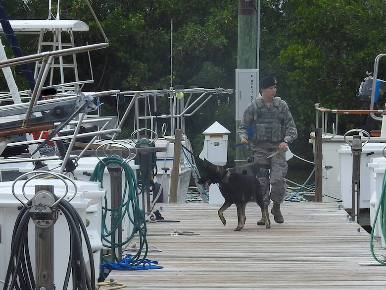 SSgt Frances Hopfer, security forces handler, and her military working dog, Digo, conduct final safety checks of the marina at Patrick Air Force Base, Florida, Sept. 9, 2017. The marina was secured after the 45th Space Wing entered hurricane condition levels for Hurricane Irma.