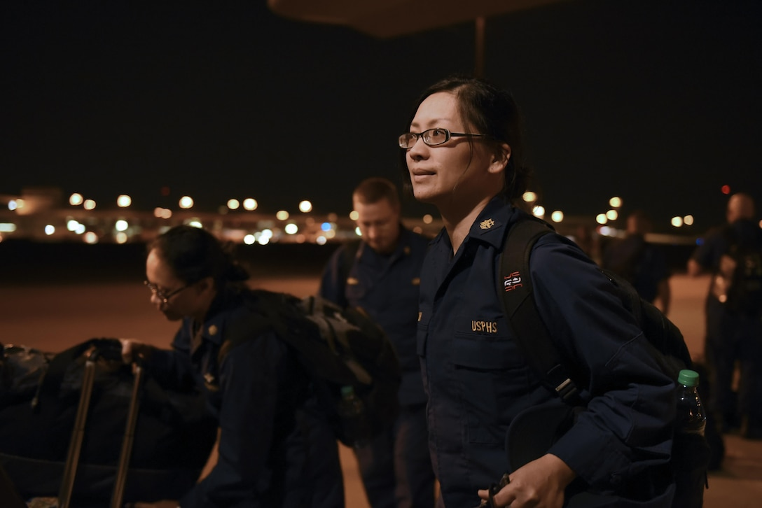 Capt. Aileen Renolayan, U.S. Public Health Service Rapid Deployment Force 5 member, boards a C-130J headed to Orlando International Airport, Fla., Sept. 9, 2017, at the Dallas Fort Worth International Airport Dallas, Texas. The C-130J, assigned to the 41st Airlift Squadron at Little Rock Air Force Base, Ark., also picked up Disaster Medical Assistance Team personnel from Alabama, Kentucky, Tennessee and Ohio to prepare for relief efforts medical after the anticipated fallout from Hurricane Irma. (U.S. Air Force photo by Senior Airman Mercedes Taylor)