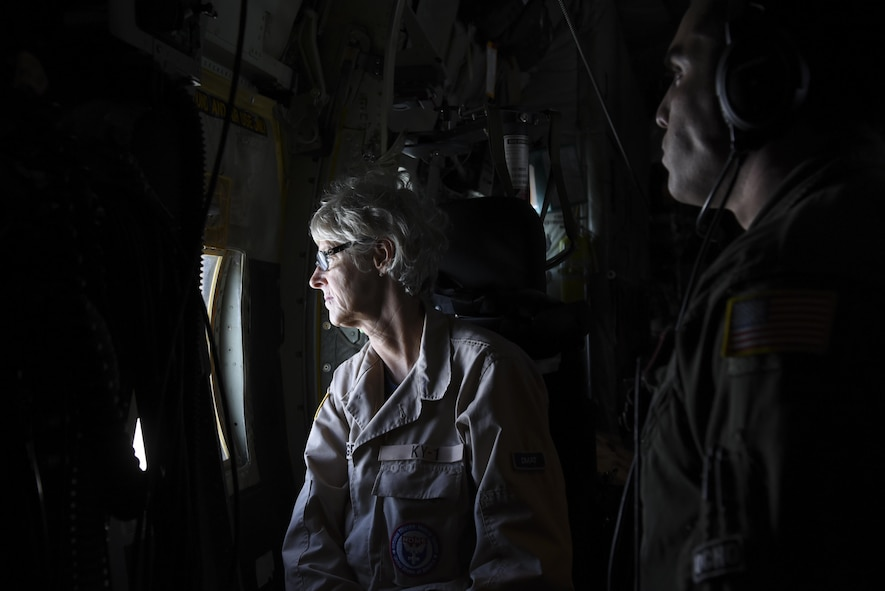 (From left) Scar Padgett, KN-1 Disaster Medical Assistance Team registered nurse, and Staff Sgt. Efrain Huereque, 41st Airlift Squadron loadmaster, glance out of a C-130J headed to Orlando International Airport, Fla., mid-flight Sept. 9, 2017. The 41st AS stationed at Little Rock Air Force Base, Ark., delivered state Disaster Medical Assistance Teams and U.S. Public Health Rapid Deployment Force personnel to Florida to prepare for Hurricane Irma relief efforts. (U.S. Air Force photo by Senior Airman Mercedes Taylor)