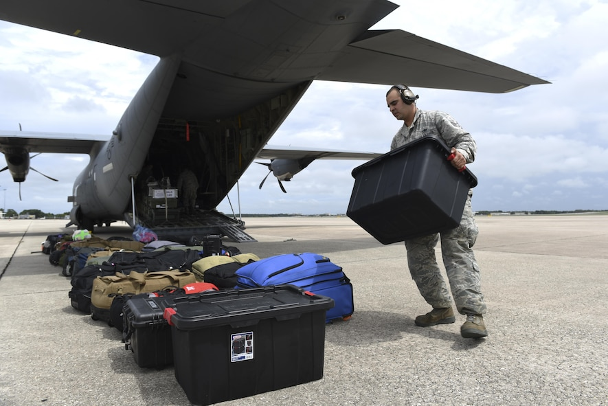 Staff Sgt. Kyle Chambasian, 19th Aircraft Maintenance Squadron flying crew chief, unloads medical equipment from a C-130J assigned to the 41st Airlift Squadron, Sept. 9, 2017, at Orlando International Airport, Fla. The 41st AS delivered medical personnel from state Disaster Medical Assistance Teams and U.S. Public Health Rapid Deployment Force personnel to Florida to prepare for Hurricane Irma relief efforts. Response teams brought triage kits, pharmaceuticals and basic medical supplies for relief efforts. (U.S. Air Force photo by Senior Airman Mercedes Taylor)