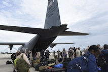 State Disaster Medical Assistance Teams and U.S. Public Health Rapid Deployment Force personnel gather their luggage and medical supplies after arriving in a C-130J assigned to the 41st Airlift Squadron, to Orlando, Fla., Sept. 9, 2017. The 41st Airlift Squadron, stationed at Little Rock Air Force Base, Ark., delivered medical response teams to Florida to prepare for relief efforts after Hurricane Irma. (U.S. Air Force photo by Senior Airman Mercedes Taylor)