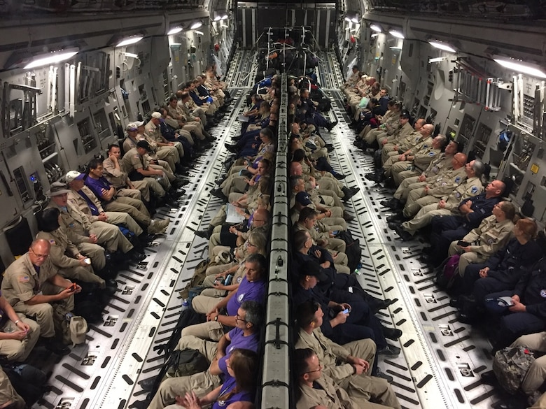 Healthcare professionals requested by the National Disaster Medical System and the U.S. Department of Health and Human Services are aboard a C-17 Globemaster III as part of the Hurricane Irma response.