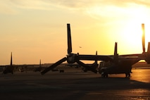 A CV-22 Osprey, along with other aircraft assigned to Hurlburt Field, Fla., is parked on the flightline after landing Sept. 9, 2017, at Little Rock Air Force Base, Ark. The aircraft is capable of extremely accurate navigation due to the fully integrated navigation systems with dual inertial navigation systems and global positioning system. (U.S. Air Force photo by Airman 1st Class Grace Nichols)