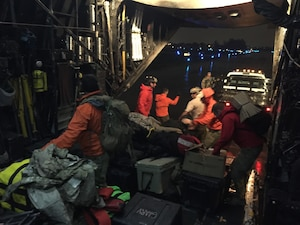 U.S. Air Force Guardian Angel pararescuemen from the 212th Rescue Squadron, Alaska Air National Guard, unload their equipment from an MC130P Combat Shadow aircraft assigned to the 129th Rescue Wing for support during Hurricane Irma.