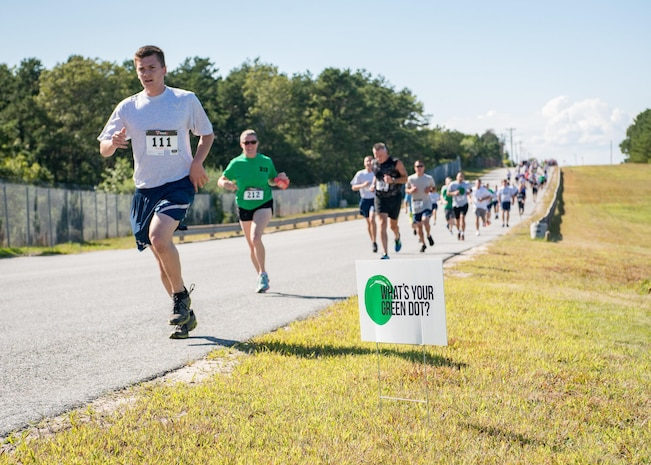 Airmen from the 102nd Intelligence Wing participate in a 5k to raise awareness of the Green Dot program. Green Dot is a non-profit program that aims to prevent incidents of violence.