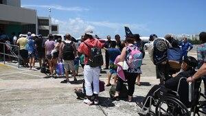 Rescued U.S. citizen from the island of St. Maarten enter the Luis Muñoz Marin International Airport in Carolina, Puerto Rico, Sept.9.
