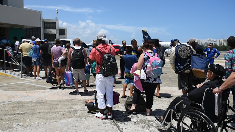 Rescued U.S. citizen from the island of St. Maarten enter the Luis Muñoz Marin International Airport in Carolina, Puerto Rico, Sept.9.