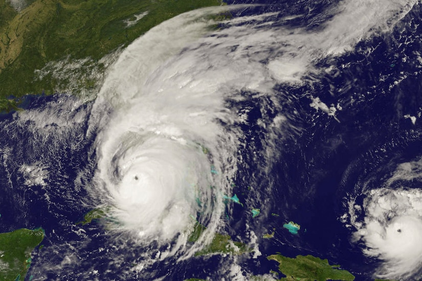 Satellite imagery shows a massive circular white storm cloud over Florida.