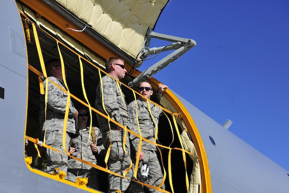 Members of the 113th Wing, D.C. Air National Guard, look out the door of a 459th Air Refueling Wing KC-135 Stratotanker at Joint Base Andrews, Maryland, Sept. 9, 2017.  Aircrews from the 459th ARW picked up the guardsmen at Tyndall Air Force Base, Florida, earlier in the day due to the threat of Hurricane Irma. (U.S. Air Force photo by Tech. Sgt. Brent A. Skeen)