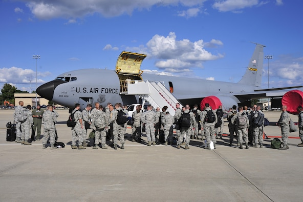 Members of the 113th Wing, D.C. Air National Guard, stand on the flight line in front of a 459th Air Refueling Wing KC-135 Stratotanker at Joint Base Andrews, Maryland, Sept. 9, 2017. Aircrews from the 459th ARW picked up the guardsmen at Tyndall Air Force Base, Florida, earlier in the day due to the threat of Hurricane Irma. (U.S. Air Force photo by Tech. Sgt. Brent A. Skeen)